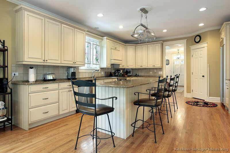 Black or country antique white kitchen cabinets for Antique white kitchen cabinets